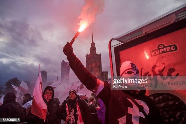Member of a far right group holds a flare in the streets of Warsaw celebrating the Independence Day of Poland On Saturday 11 November 2017 in Warsaw...