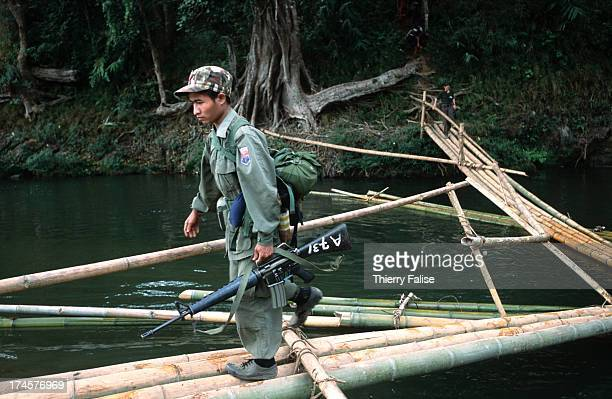 A member of a Free Burma Rangers expedition team on the way to find and bring relief to refugees hiding in the jungles