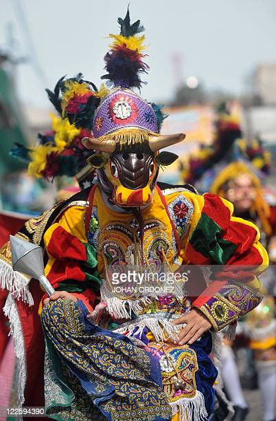 A member of a Guatemalan folk group performs the traditional 'El Torito' dance on August 28 2011 during the celebration of San Agustin in Sumpango...