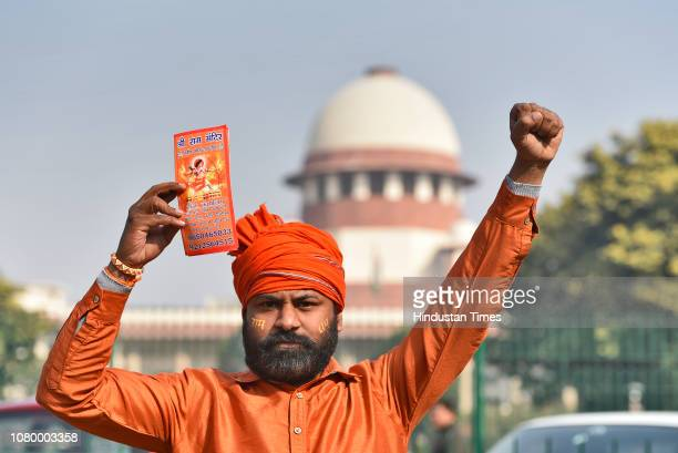 A member of a Hindu group holds a placard during a protest to demand the construction of the Ram Temple near the Supreme Court on January 10 2019 in...