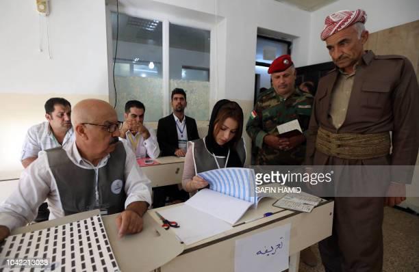 A member of a Kurdish Peshmerga battalion casts his vote for the parliamentary election in Iraq's autonomous Kurdish region in Arbil on September 28...