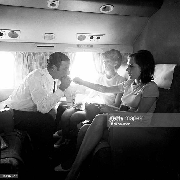 Member of a LAN Airways flight crew take a cigarette break during a flight 1960s