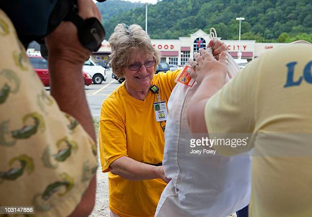 A member of a local church disaster relief group Carolyn Gray drops off loads of laundry for victims who are stuck with no way to leave their...