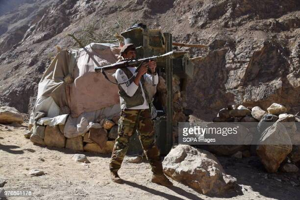 BADAKHSHAN AFGHANISTAN Member of a local militia armed with an RPG rocket launcher in front of a makeshift bunker outpost to protect the lapis lazuli...