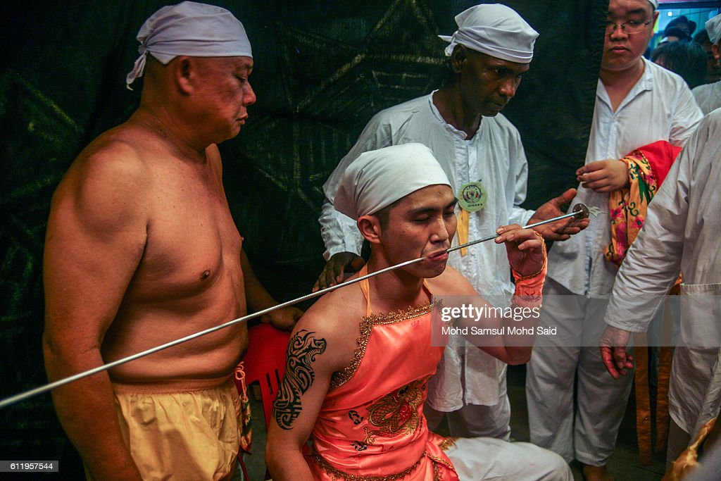 Member of a Malaysian ethnic Chinese community has his cheeks pierced with a skewer perform a ritual prayer during the Nine Emperor Gods Festival at a temple on October 2, 2016 in Kuala Lumpur, Malaysia. The Nine Emperor Gods Festival welcomes the emperor gods that live in the stars under the reign of 'Thien Hou' or the 'Queen of Heaven' who brings good fortune, longevity and good health. Some devotees stay at a temple during the nine-day Taoist celebration, beginning on the eve of the ninth lunar month of the Chinese calendar, consume vegetarian meals and recite continuous prayers.