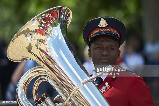 A member of a marching band prepares to take part in a march to celebrate the 150th anniversary of the Salvation Army on July 5 2015 in central...