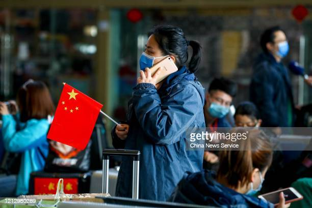Member of a medical assistance team from Henan province holds a national flag at Wuhan Railway Station on March 17, 2020 in Wuhan, Hubei Province of...