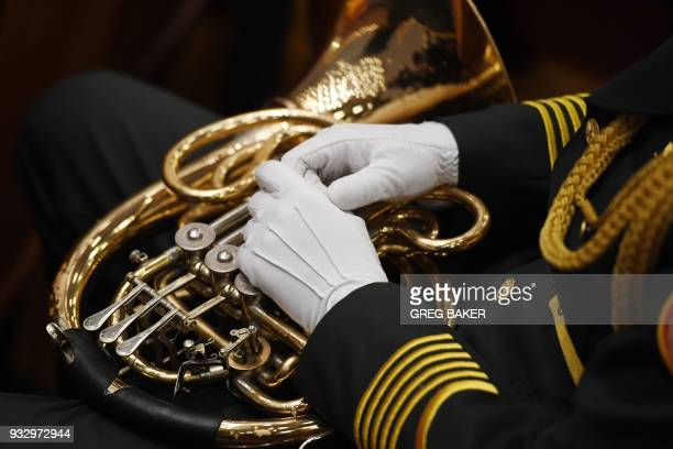 A member of a military band prepares to play the national anthem during the fifth plenary session of the first session of the 13th National People's...