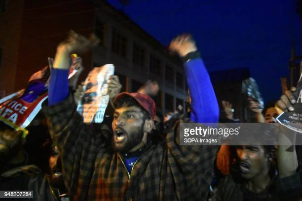 A member of a nomadic Gujjar community shout slogans during a night protest against the rape and murder of an eightyearold girl in Srinagar Indian...