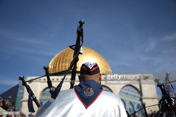A member of a Palestinian marching band performs with a bagpipe during the celebrations for Mawlid alNabi the birth anniversary of Muslims' beloved...