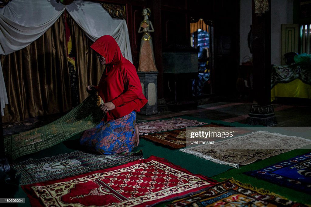 A member of a Pesantren boarding school, Al-Fatah, for transgender people known as 'waria' prepares for pray during Ramadan on July 12, 2015 in Yogyakarta, Indonesia. During the holy month of Ramadan the 'waria' community gather to break the fast and pray together. 'Waria' is a term derived from the words 'wanita' (woman) and 'pria' (man). The Koran school Al-Fatah was set back last year's by Shinta Ratri at her house as a place for waria to pray, after their first founder Maryani died. The school operates every Sunday. Islam strictly segregates men from women when praying, leaving no-where for 'the third sex' waria to pray before now.