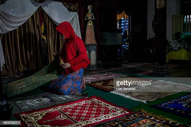 Member of a Pesantren boarding school, Al-Fatah, for transgender people known as 'waria' prepares for pray during Ramadan on July 12, 2015 in...
