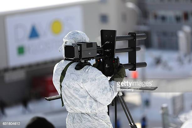 A member of a police unit practices using an antidrone gun as part of the security exercises ahead of the World Economic Forum in Davos Switzerland...