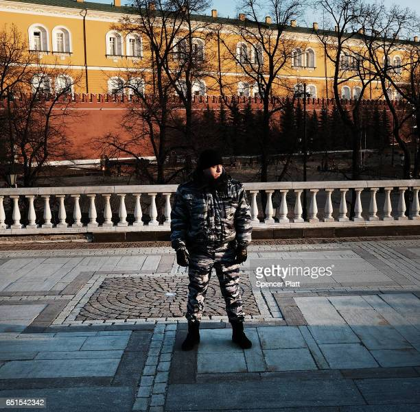 A member of a Russian security service stands in front of the Kremlin in Moscow on March 10 2017 in Moscow Russia Relations between the United States...