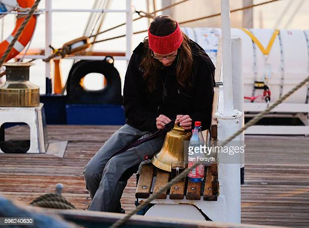 A member of a ships crew polishes brasswork on deck during the North Sea Tall Ships Regatta on August 27 2016 in Blyth England The bustling port town...