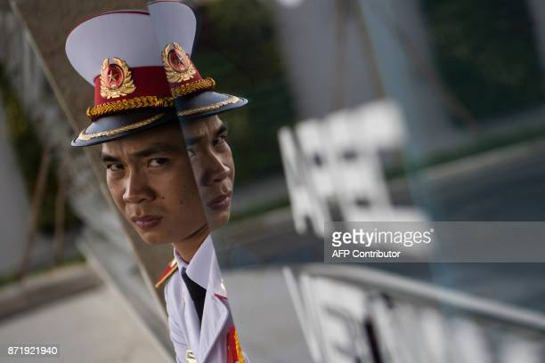 TOPSHOT A member of a Vietnamese honour guard stands guard during the arrivals of leaders at the international airport ahead of the AsiaPacific...