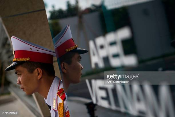 A member of a Vietnamese honour guard stands guard during the arrivals of leaders at the international airport ahead of the AsiaPacific Economic...