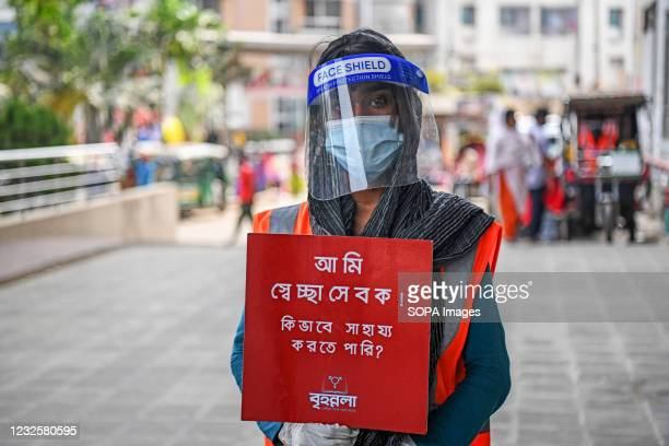 Member of a voluntary organization called Brihannala poses for a picture in front of the hospital. They provide services to patients at Dhaka Medical...