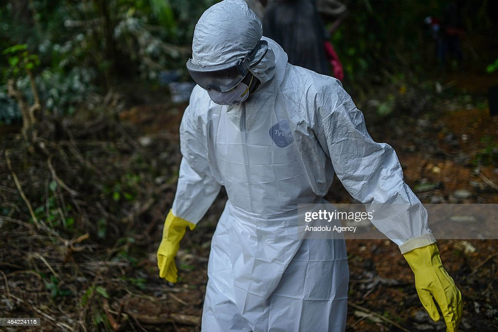 A member of a volunteer medical team wears special uniform for the burial of 7 people, sterilized after dying due to the Ebola virus, in Kptema graveyard in Kenema, Sierra Leone on August 26, 2014. In recent months, Ebola a contagious disease for which there is no known treatment or cure has claimed at least 1429 lives in West Africa, mostly in Sierra Leone, Guinea and Liberia.
