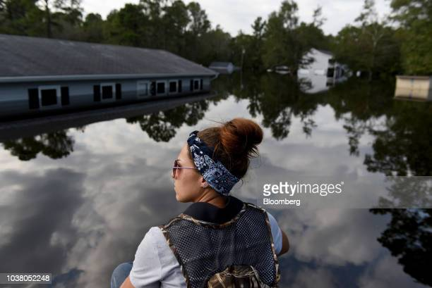 Member of a volunteer search and rescue team rides a boat to check homes for animals stranded in floodwater after Hurricane Florence hit in Bergaw,...