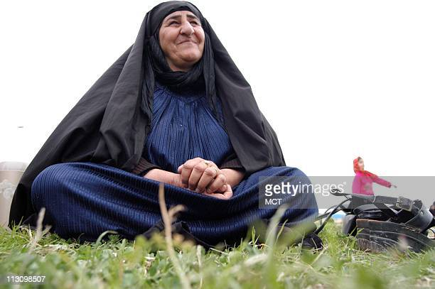 A member of a warstriken family in QasreShirin Iran spends a Saturday in Basij Park where a wedding takes place on February 15 2003 The park is on a...