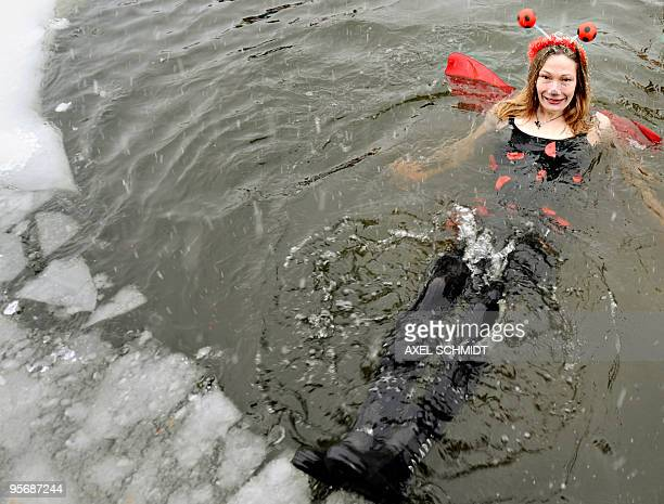 A member of a winter bathing association takes the annual bath in the frozen Orankesee lake on January 09 2010 in Berlin Most of the bathers stayed...