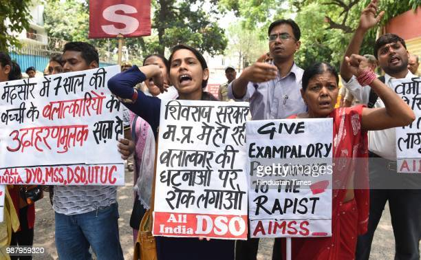 Member of AIMSS AIDSO AIDYO hold placards and shout slogans during a protest against the brutal rape of a sevenyearold girl in Mandsaur Madhya...