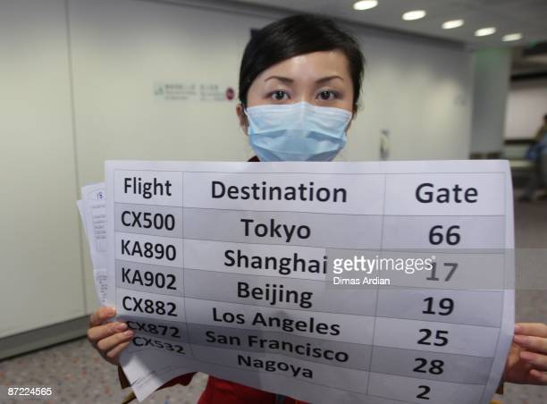 A member of airline groundstaff is seen wearing a mask at Hong Kong International Airport on May 14 2009 in Hong Kong China Following the 2003 SARS...