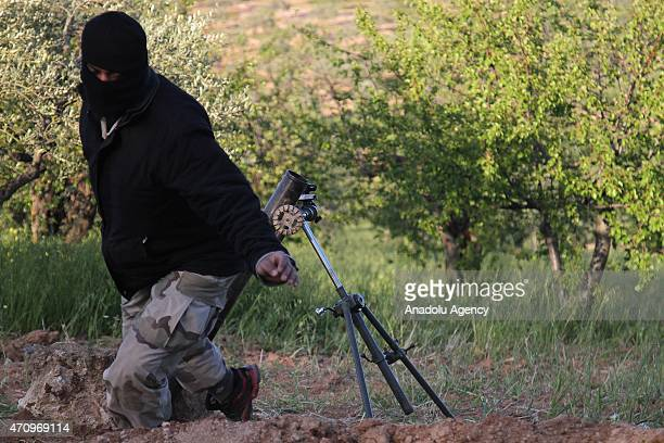 A member of alFatah forces is seen after firing artillery as they attack the regions where the Assad regime forces are located in the town of Jisr...