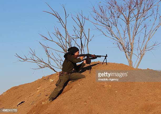 A member of AlSultan Murad Brigade armed opposition group takes position as they clash with Daesh Terroists around the Harcele village in northern...