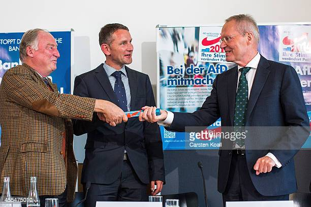 Member of Alternative fuer Deutschland political party HansOlaf Henkel gets a baton by AfD Brandenburg lead candidate Alexander Gauland and AfD...