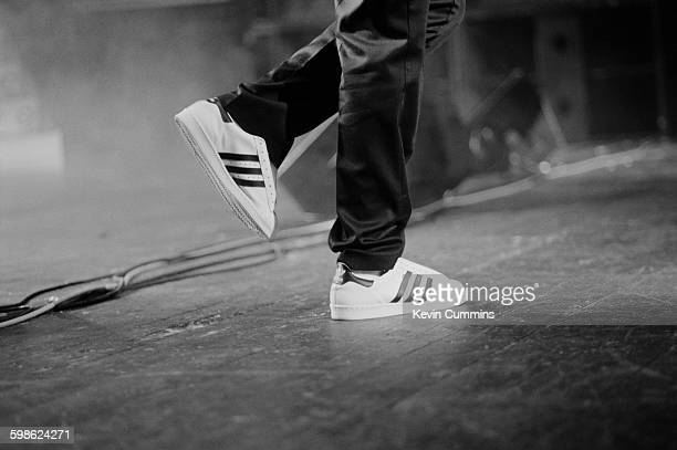 A member of American hip hop group Public Enemy performing on stage in Brixton London circa 1990