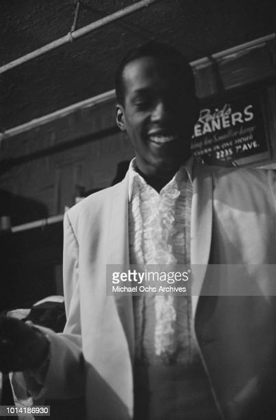 A member of American vocal group The Temptations backstage at the Apollo Theatre in New York City circa 1965