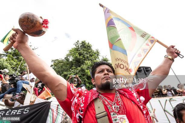 A member of Amerindian communauty Kali'na gestures during a protest over security and the state of the economy at Kourou space center on April 4 2017...
