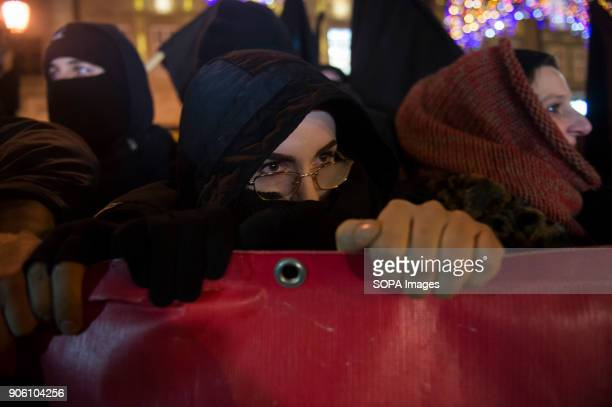 A member of an anti fascist organization attend a protest against proposals to tightening of abortion laws at the Main Square in Wroclaw Women...