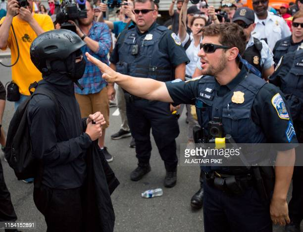 A member of an antifascist or Antifa group argues with police as they try to reach the AltRight Demand Free Speech rally in Washington DC July 6 2019