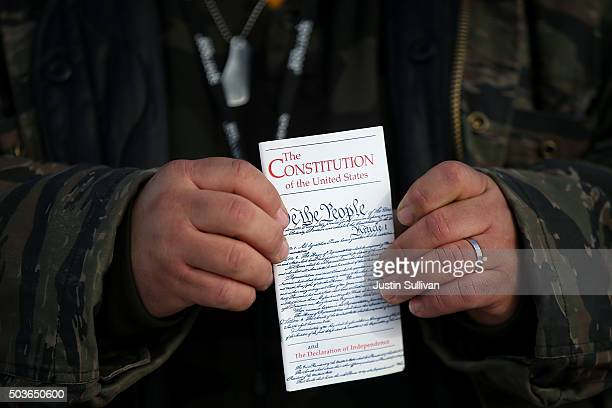 A member of an antigovernment militia holds a copy of the US Constitution at the Malheur National Wildlife Refuge Headquarters on January 6 2016 near...