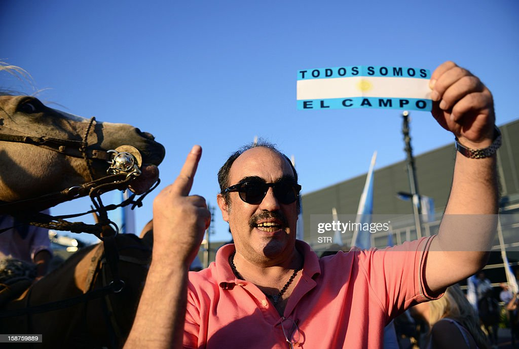 A member of an Argentinian rural organization gestures during a protest against a decree issued by President Cristina Fernandez de Kirchner to expropiate the Rural Society grounds and give it back to the state, on December 27, 2012 at the Rural Society grounds in Buenos Aires.