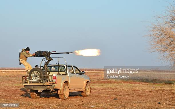 A member of an armed opposition group linked to Mutasim brigade attack Daesh militants near the village of Harbe in Aleppo Syria on December 20 2015