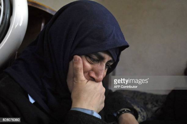 A member of an Armenian Christian family who fled from Raqa cries while sitting at a house in Jazra a western suburb of the northern Syrian city on...