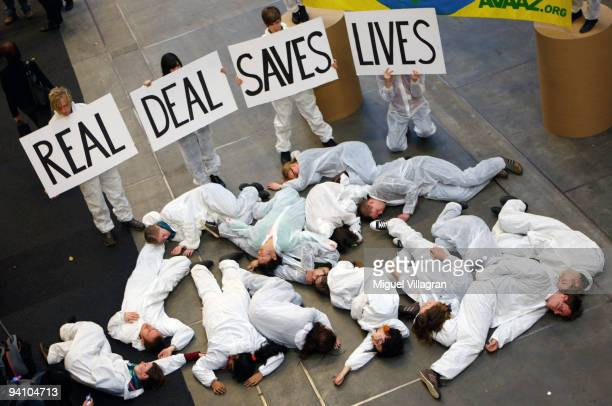 Member of an environmentalist group pretend to be dead during a protest demanding a real climate deal during the first day of United Nations Climate...