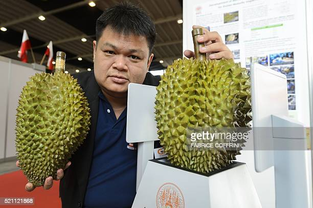 Member of an inventor team Sorawat Chivapreecha of Thailand shows a durian fruit placed onto a microwave sensor for durian fruits maturity inspection...