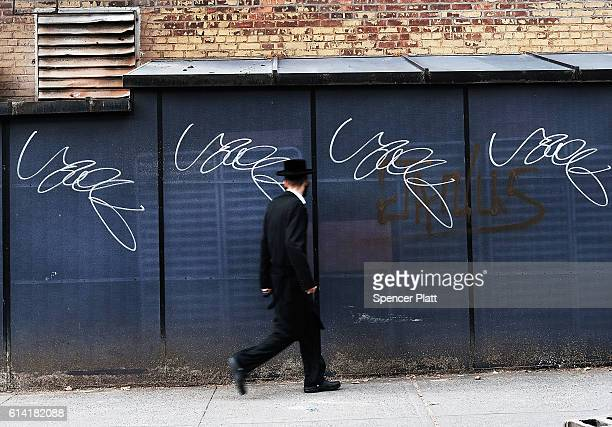 A member of an Orthodox Jewish community in Williamsburg Brooklyn walks through the neighborhood on Yom Kippur one of the most important holidays of...