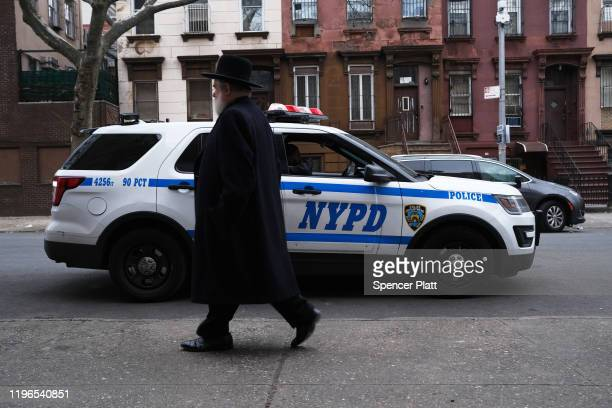 A member of an Orthodox Jewish community walks through a Brooklyn neighborhood on December 29 2019 in New York City Five Orthodox Jews were stabbed...