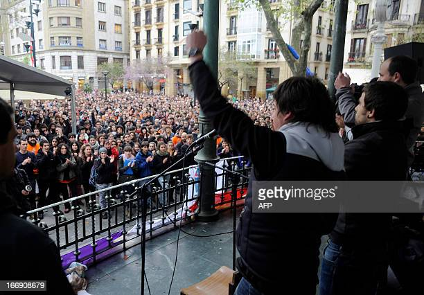 Member of Basque proindependence youth organization SEGI Oier Lorente raises his fist after delivering a speech in the northern Spanish Basque city...