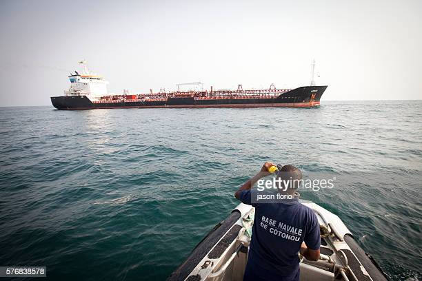 A member of Benin's antipiracy team checks on a vessel near the port of CotonouBenin Piracy off the small west African country of Benin has risen...