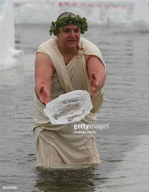 A member of Berlin's ice swimming club 'Berliner Seehunde' throws an ice block after he took a dip in Orankesee lake on January 10 2009 in Berlin...