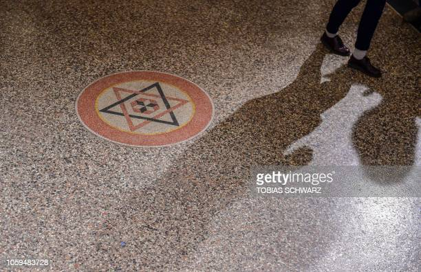 A member of Berlin's Jewish Community walks past the Star of David inside the Synagogue Rykestrasse in Berlin prior to a ceremony on November 9 2018...