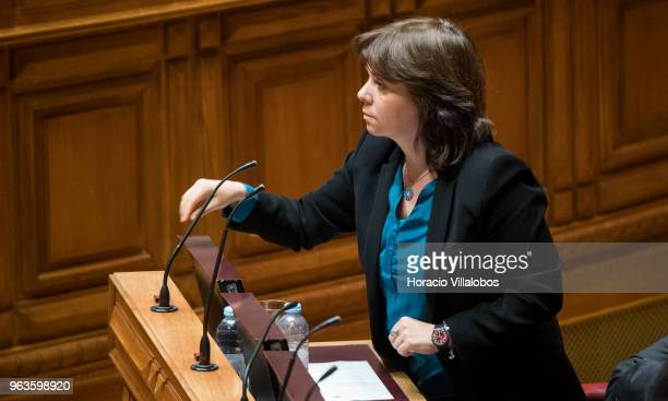 Member of Bloco de Ezquerda Catarina Martins gestures while voting in favor of projects during the Portuguese Parliament debate on euthanasia...