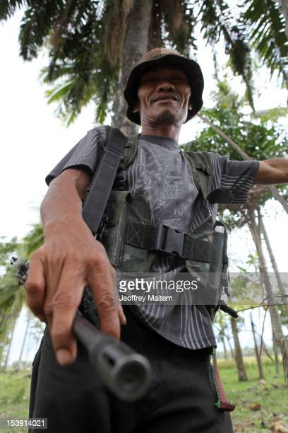 Member of breakaway faction of the Moro Islamic Liberation Front is armed and awaiting the signing of an agreement between their former colleagues...